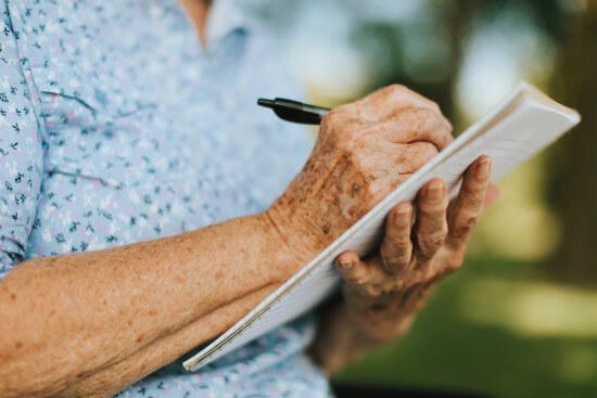 elderly-woman-writing